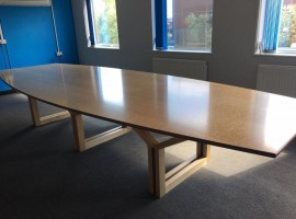 Stunning conference table in birdseye maple with Walnut inlays