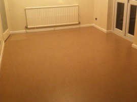 Vinyl flooring fitted and walls, ceiling, skirtings painted